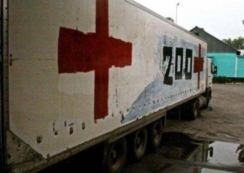 Загиблих путінських вояк вантажівками вивозять з Донбасу